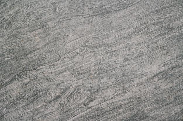 검은 돌 바닥 텍스처를 배경으로 사용할 수 있습니다. 프리미엄 사진