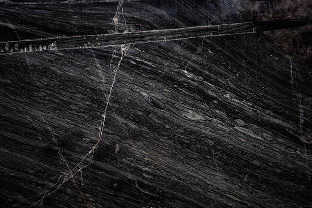 Black stone texture background cracked stone Premium Photo