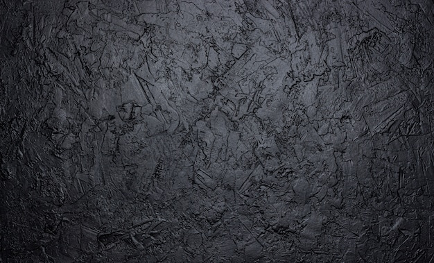 Black stone texture, dark slate background Premium Photo