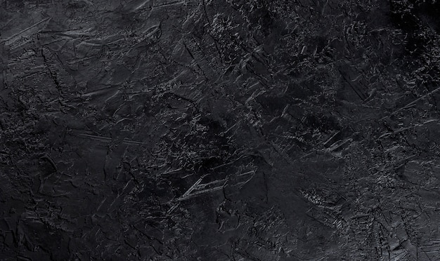 Black stone texture, top view Premium Photo