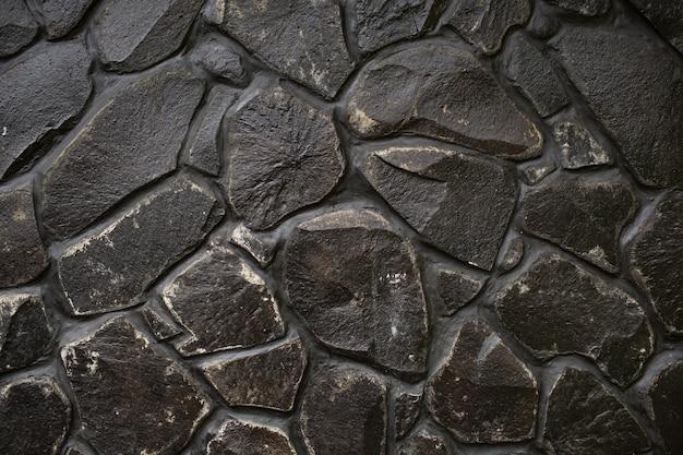 Черная каменная стена текстуры. бали. индонезия Бесплатные Фотографии