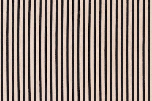 Black striped pattern on cream background Free Photo