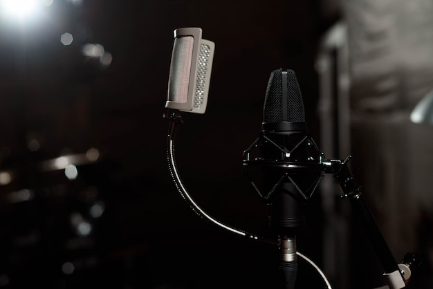 Black vocal microphone is stand in sound recording studio room Premium Photo
