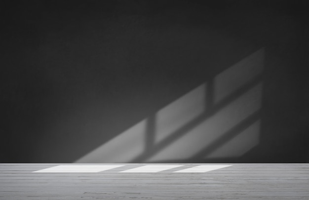 Black wall in an empty room with concrete floor Premium Photo