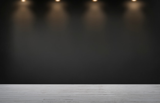 Black wall with a row of spotlights in an empty room Free Photo
