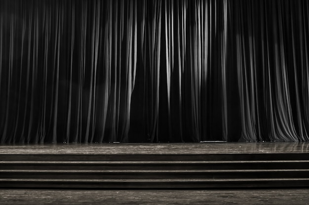 Black and white curtains and wooden stage. Premium Photo
