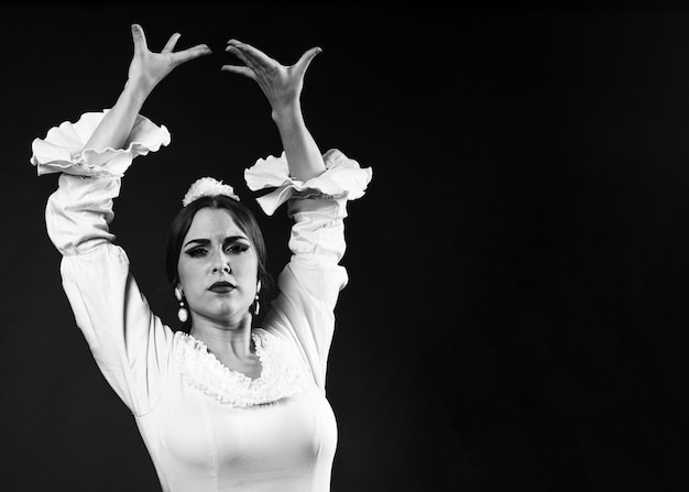 Black and white flamenca with hands up Free Photo