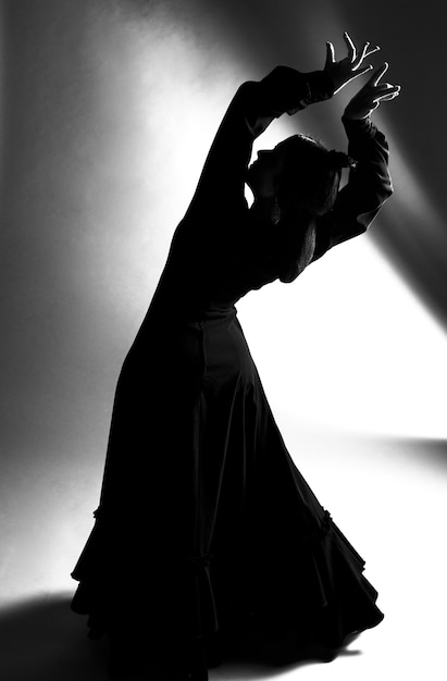 Black and white full shot dancer bending back Free Photo