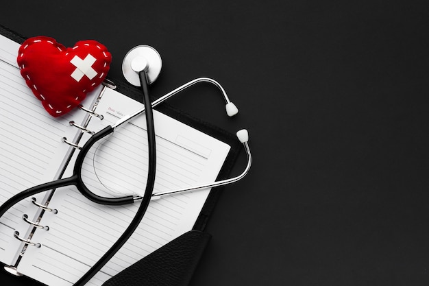 Black and white medical concept with stethoscope and red heart Premium Photo