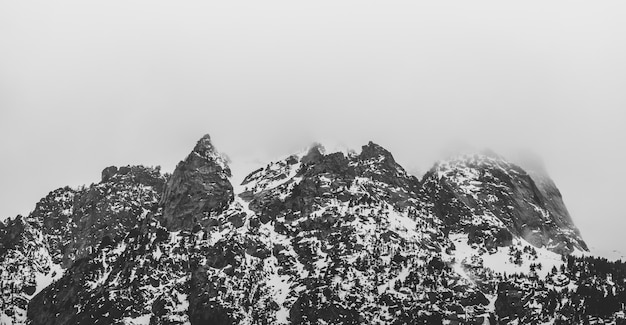 Black and white mountain with snow and fog Free Photo