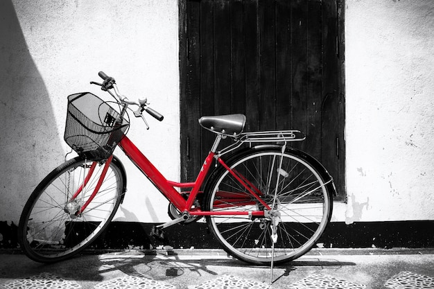 Black and white photo of red bicycle - vintage film grain filter