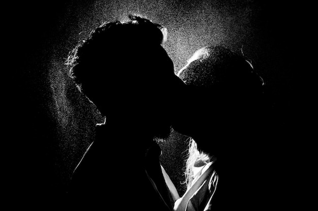 Black and white silhouette of a kissing couple Premium Photo