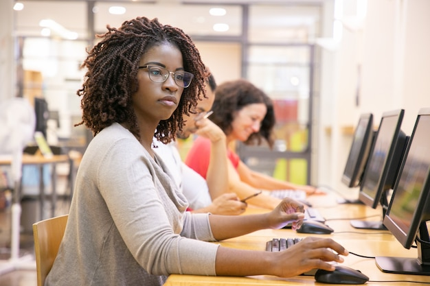 Black woman adult student working in computer class Free Photo