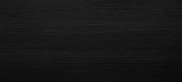 Black wooden texture background with abstract pattern surface. Premium Photo