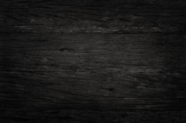 Black wooden wall background, texture of dark bark wood with old natural pattern for design art work, top view of grain timber. Premium Photo