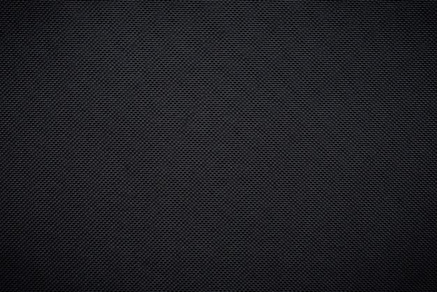 Black woven carbon fiber sheet texture background Premium Photo