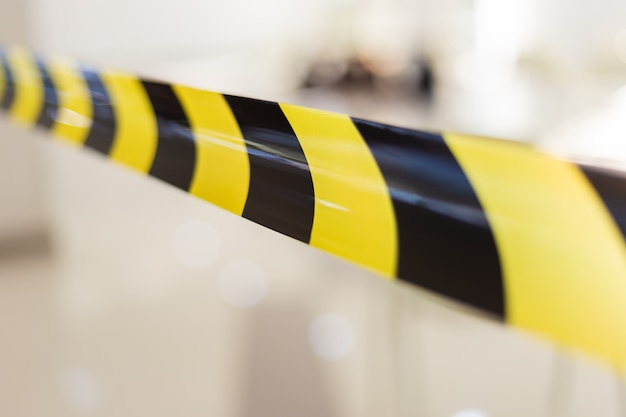 Black and yellow barrier tape for partition danger zone. Premium Photo