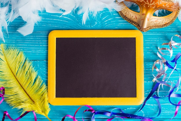Blackboard and carnival decorations Free Photo