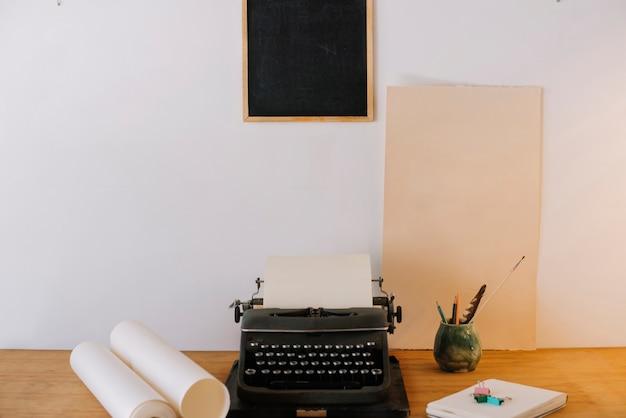 Blackboard hanging over typewriter Free Photo
