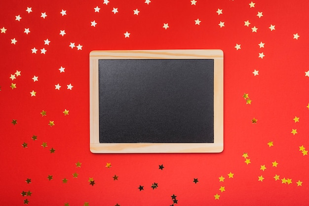 Blackboard mock-up with red background and golden stars Free Photo