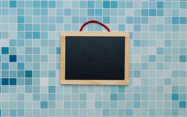 Blackboard on a pool background Free Photo