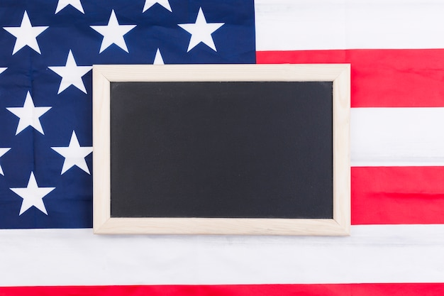 Blackboard on usa flag background in honour of independence day Free Photo