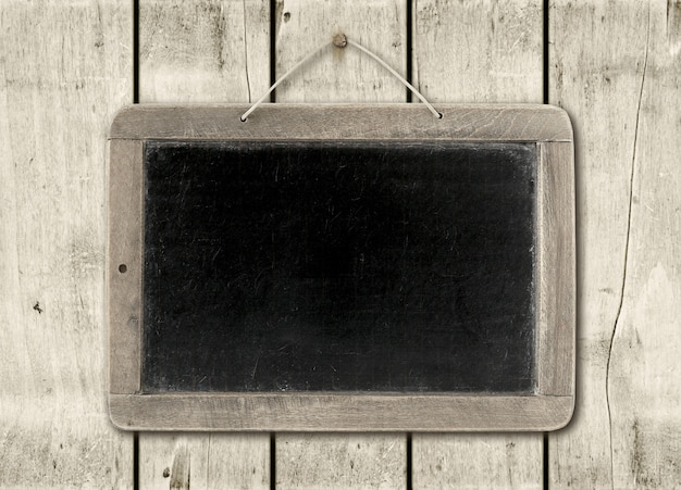 Blackboard on a white wood wall Premium Photo