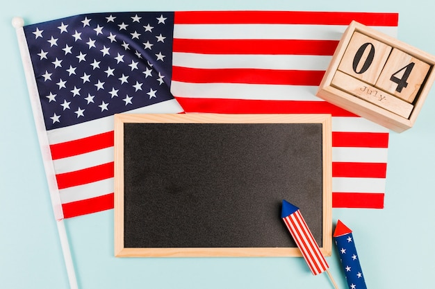Blackboard with flag and firecrackers Free Photo