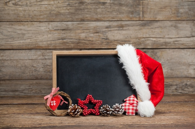 Blackboard with a hat santa claus Free Photo