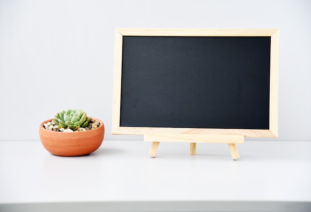 Blackboard with succulent plants and cactus on the table Copy space Premium Photo