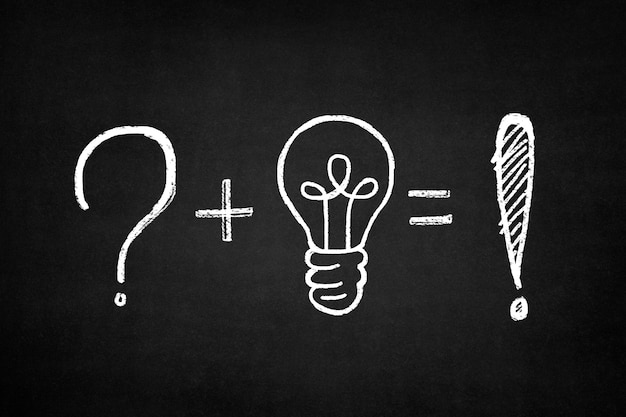 Blackboard with a sum of a question mark and a light bulb Free Photo