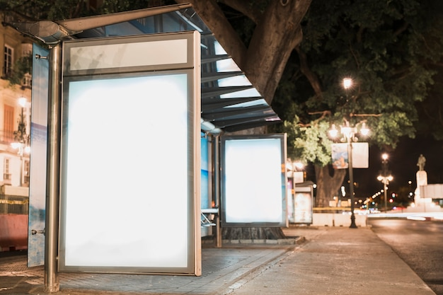 Blank advertisement billboard at bus stop near street Free Photo