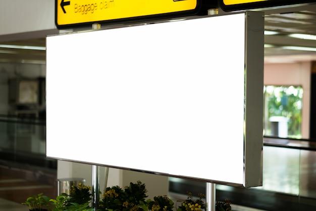 Blank advertising billboard at airport Premium Photo