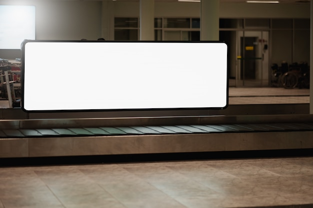 Blank advertising billboard at airport. Premium Photo
