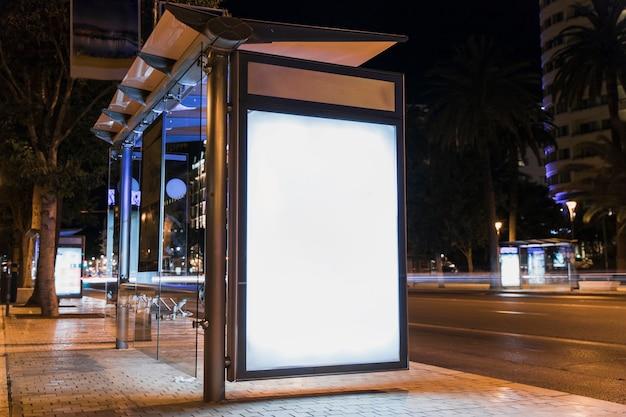 Blank advertising billboard on city bus stop Free Photo