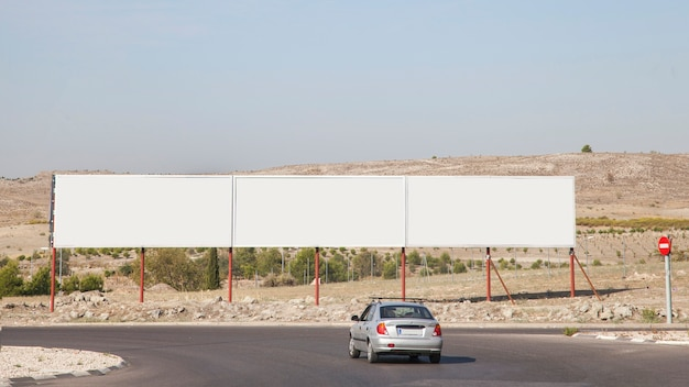 Blank advertising billboards near the highway Free Photo