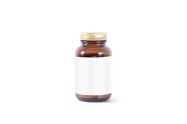 Пустая таблетка из янтарного стекла с белой этикеткой, изолированные Premium Фотографии