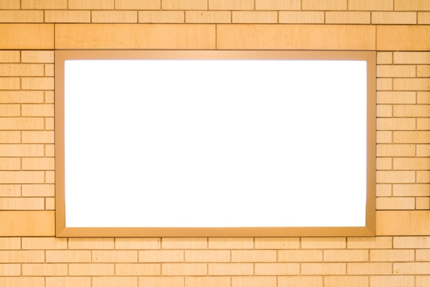 Blank billboard on the brick wall Premium Photo