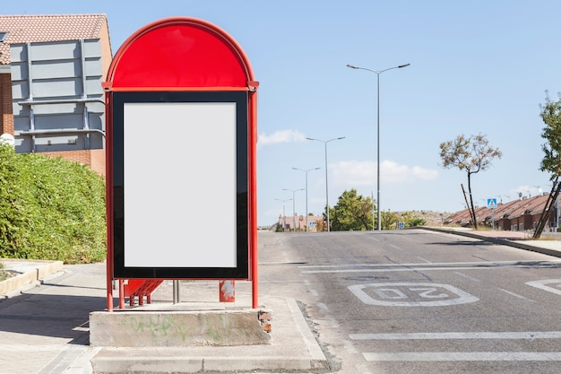 Blank billboard on city bus station by the roadside Free Photo