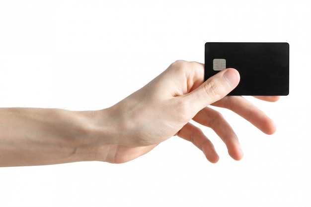 Blank black bank card in men's arm isolated on white. credit card. Premium Photo