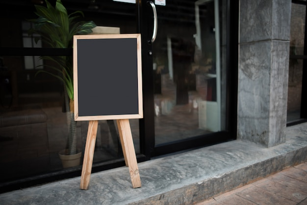Blank black chalk board in front of the cafe Free Photo