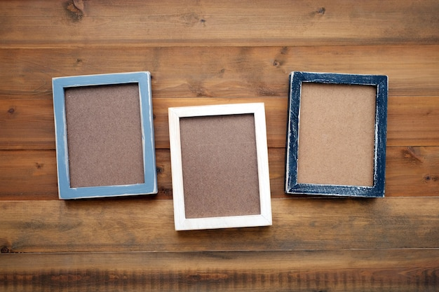 Blank black, gray and white wooden frames on vintage wood background ...