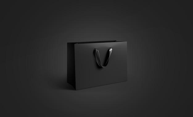 Пустой черный бумажный пакет с шелковой ручкой, изолированный Premium Фотографии