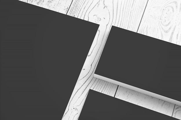 空白の黒い紙のひな形の木製デスクclode-upビューに設定 無料写真