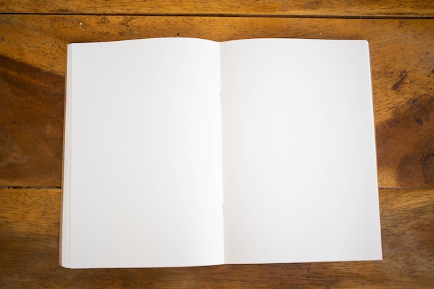 Blank book cover mock up on wood  background. Premium Photo