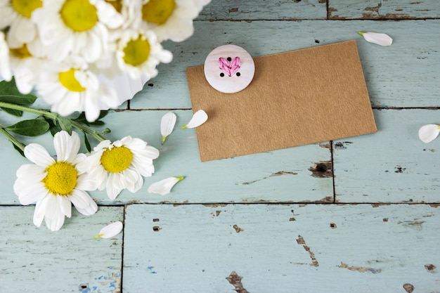 Premium Photo Blank Brown Paper Tag With Heart Embroidery And Daisy Flowers On Wood Background From a classic white daisy, to bouquets that we have daisy flowers in almost every color of the rainbow. https www freepik com profile preagreement getstarted 2544704