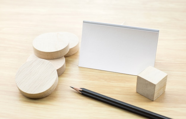 Blank business card mock up with blank wooden round piece and pencil blank business card mock up with blank wooden round piece and pencil premium photo reheart Choice Image