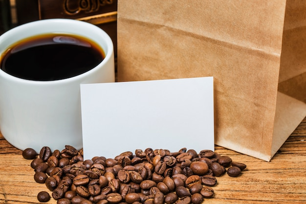 Blank business cards and cup of coffee on wooden table. corporate stationary branding mock up. Free Photo