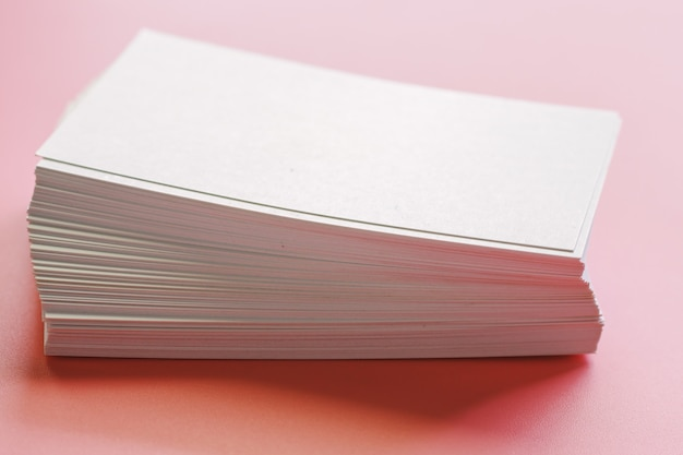 Blank business cards on pink background Premium Photo
