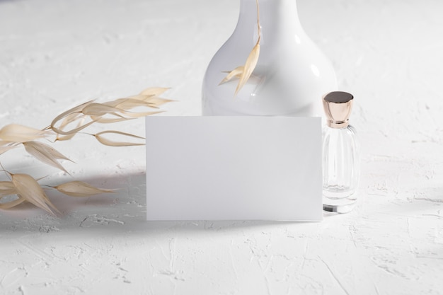 Blank card or note with dry plants flower and perfume Premium Photo